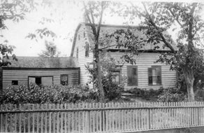 old house with a picket fence