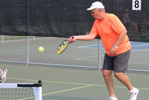 man plays pickleball