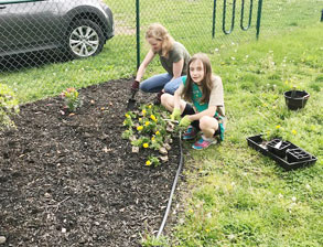 girls planting flowers