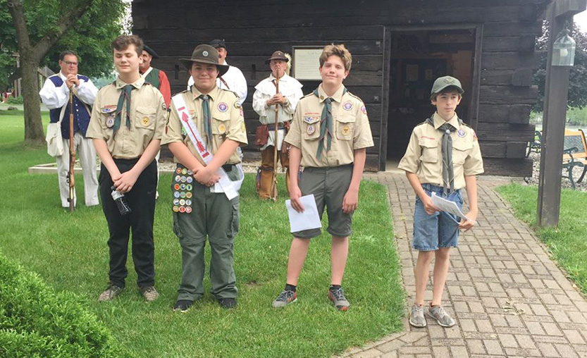 boys scouts stand together