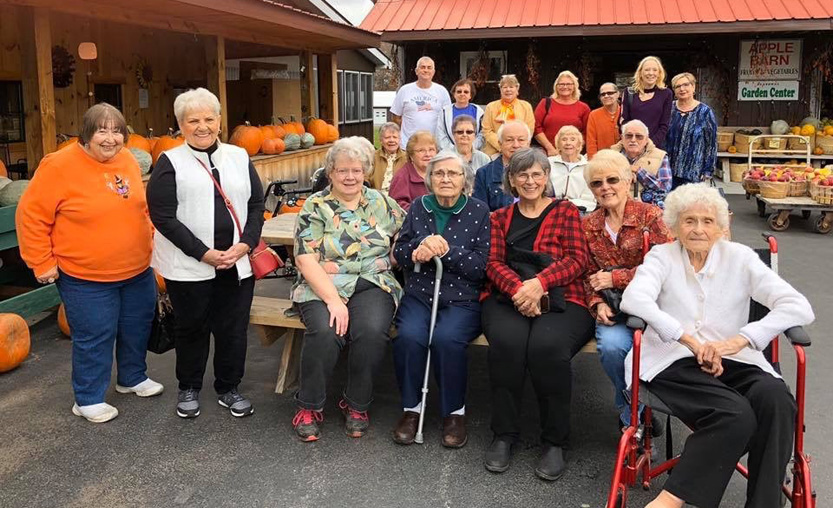 large group of senior citizens at pumpkin farm