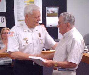 police chief shakes hands with mayor