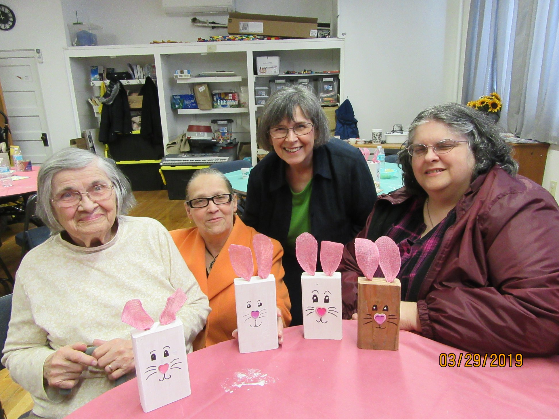 table of women with easter cards