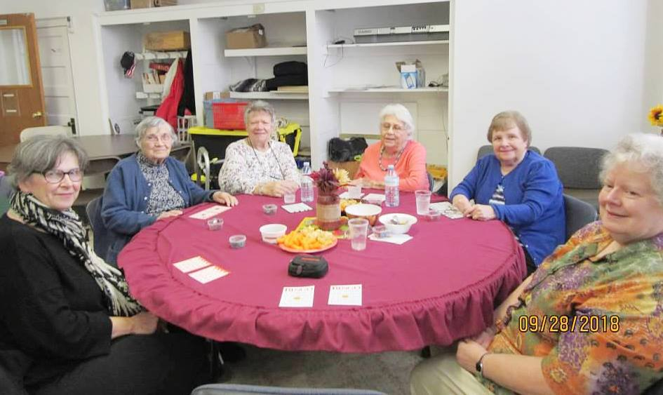 group of senior citizens at a table