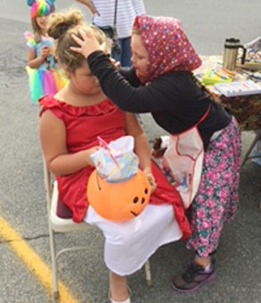 girl paints another girls face