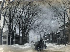 horse drawn sleigh moves through snow