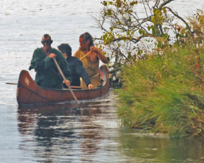 indians paddle along the hudson river