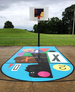 multicolored basketball court with hoop