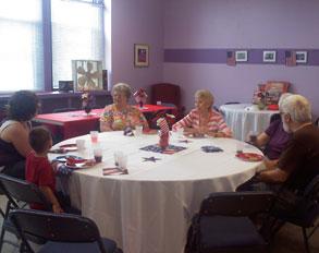 table full of senior citizens talking