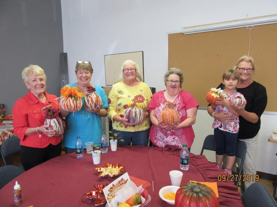 group of ladies showing off their pumpkins