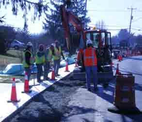 construction crews lay sidewalk concrete