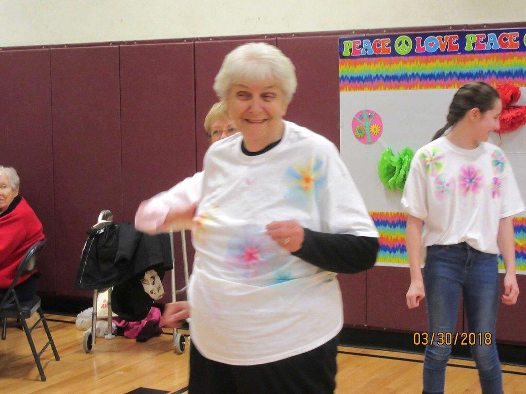 woman in ty dye shirt